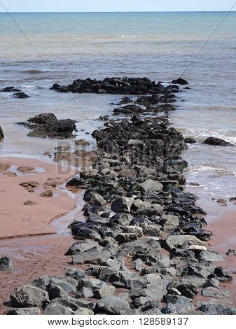 Rocky Causeway Upon Beach Seascape Photographed At Dawlish In Devon