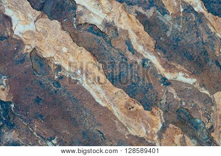 Background of a flagstone rock texture close up.