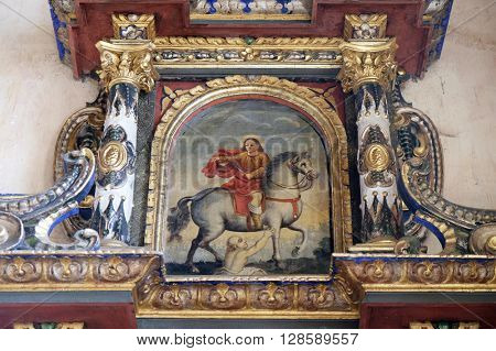 VUGROVEC, CROATIA - OCTOBER 02: Saint Martin altarpiece in the Church of Saint Saint Michael in Vugrovec, Croatia on October 02, 2015