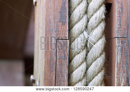 big hempen rope on the old wooden coil a closeup