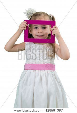 Cute little girl with white dress holding a picture frame on a white background