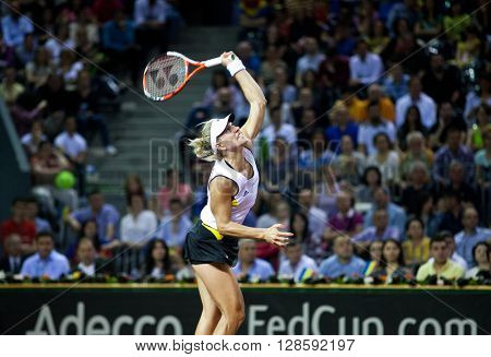 CLUJ-NAPOCA, ROMANIA - APRIL 17, 2016: Woman tennis player Angelique Kerber (WTA singles ranking 3) plays against Simona Halep during a Fed Cup match, play-offs between Romania and Germany