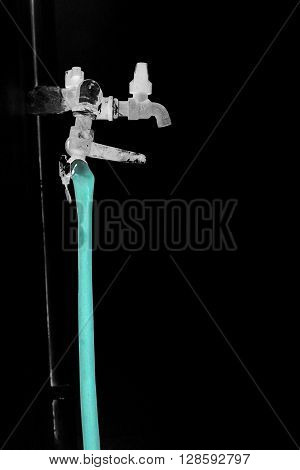 Hose and faucet three way invert photo but hose is real turquoise color isolate background black color