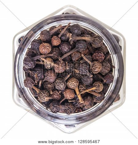 cubeb pepper in glass bottle, isolated on white background
