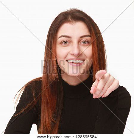 portrait of a beautiful woman pointing at you (Body language gestures psychology)