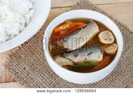 Thai food spicy mackerels fish Tom yum canned mackerels in tomato sauce on sackcloth pat.