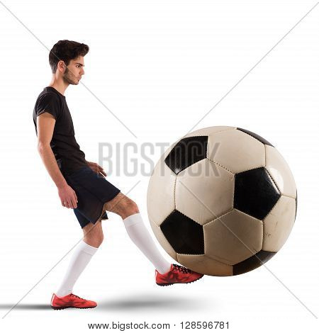 Teenage soccer player plays with big soccerball