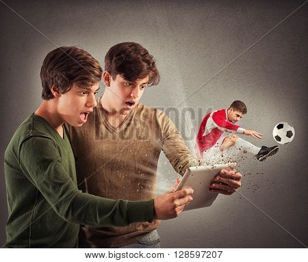 Soccer player comes out of tablet screen