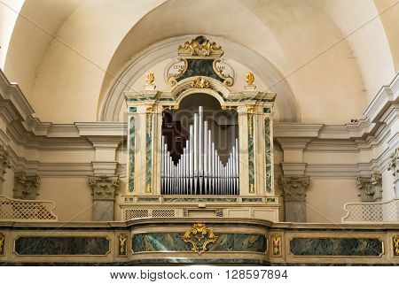 Marostica Italy - April 12 2016: Organ and choir loft above the entrance of the church of Saint Anthony Abbot.