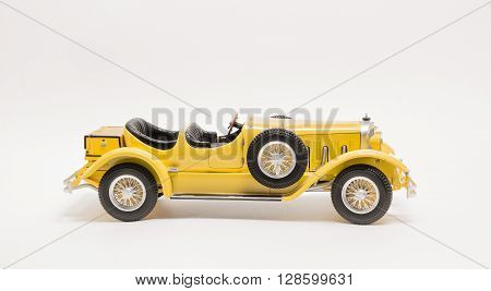 Closeup view of retro vintage classic car isolated on white background