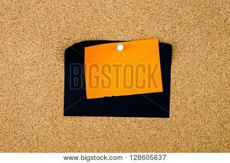 Blank Black And Orange Paper Notes Pinned On Cork Board