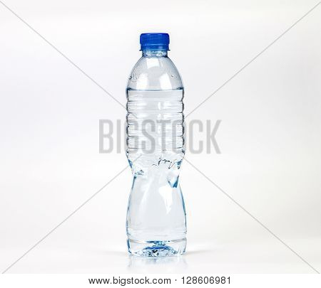 The fresh drink water bottle with small water condense drop inside bottle head on white background