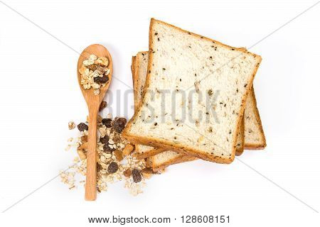the cereal and black sesame bread with whole grain cereal flakes which mixed warming cinnamon red skin apple golden raisins and roasted hazelnuts on white background