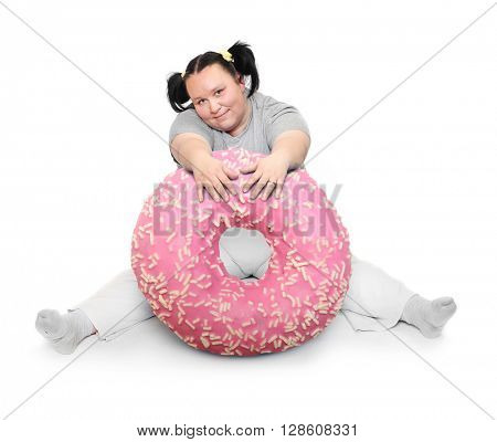 Overweight woman with big pink donut. Weight loss concept. Unhealthy food. People isolated on white background.