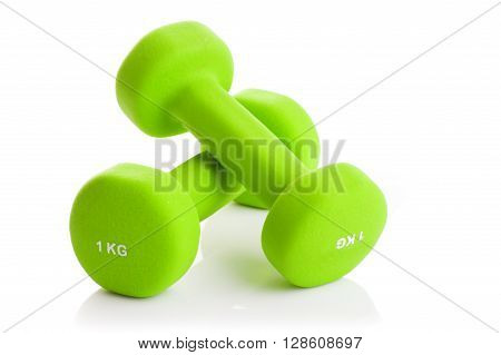 Two green dumbbells on a white background