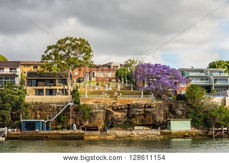 Sydney Australia - November 10 2014: Chiswick waterfront houses on the banks of the Parramatta River in cloudy weather Sydney suburb New South Wales Australia.