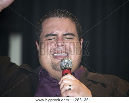BRONX NEW YORK - MARCH 17: Reverend Edgar J. Cruz performs during a Christian concert for Realizing Possibilities ministry. Taken March 17 2012 in New York.