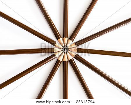 brown wooden pencil arrange as circular on the white background
