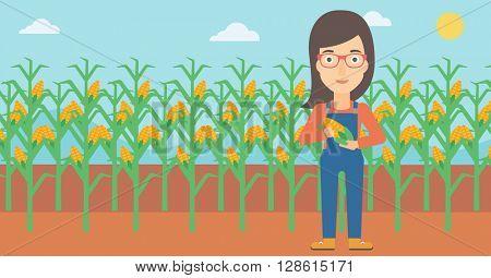 Farmer holding corn.