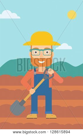 Farmer on the field with shovel.