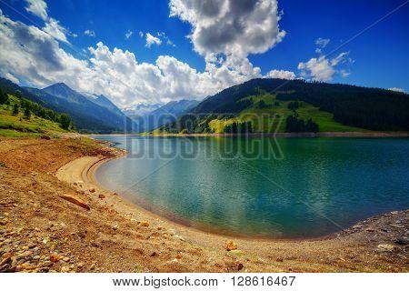 Amazing summer morning on the fantastic Speicher Durlassboden lake. Alps, Austria, Europe.