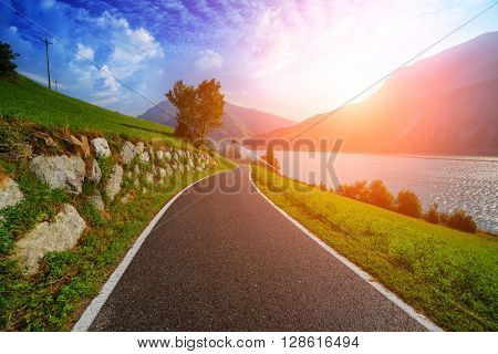 Beautiful view of the bike road on lake Resia, Alps, Italy, Europe.