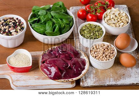 Foods High In Iron, Including Eggs, Nuts, Spinach, Beans, Seafood, Liver, Tomatoes.