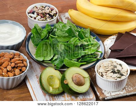 Foods High In Magnesium On A Wooden Table.