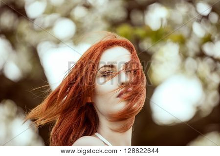 Dreammy Portrait Of Young Redhead Woman On Blured Background