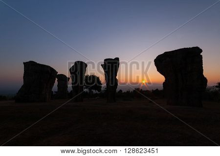 silhouette of Stone pole in sunrise time