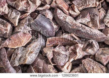 background of raw cacao nibs  - life size macro