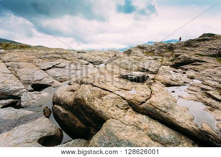 Landscape of Norwegian Mountains. Travel and Hiking Concept. Amazing Scenic View With . Scandinavia. Mountain Landscape With Silhouette Of Man Person On Horizon.