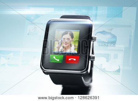 modern technology, communication, object and media concept - close up of black smart watch with video call contact icon and buttons over blue background