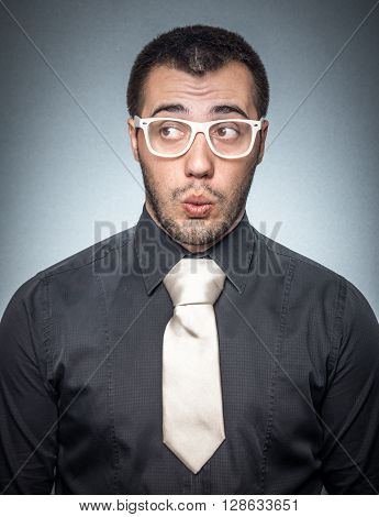 Bored Salesman Over Gray Background
