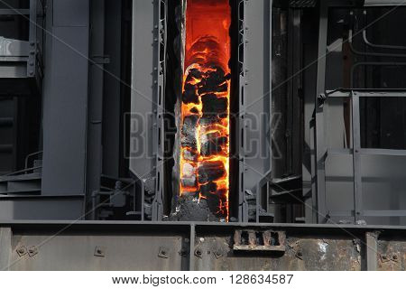 Hot coke in oven chamber prior to pushing out.