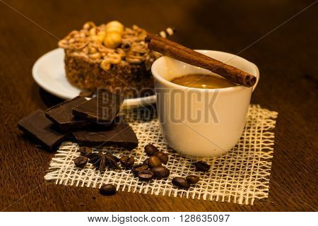 Espresso coffee on a wooden table, beans, chocolate, cinnamon, warm white Ballance