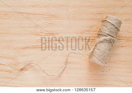 Skein jute twine on a wooden background.