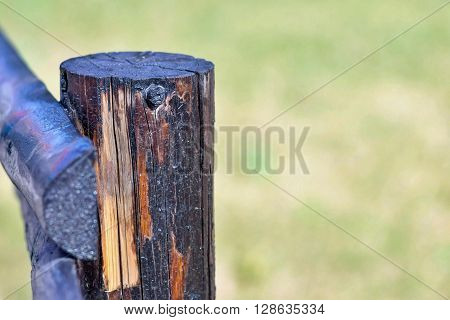 part of an old column from a wooden fence for the ranch closeup on an indistinct background