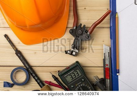 set-up of various hand and electric tools on a wooden table