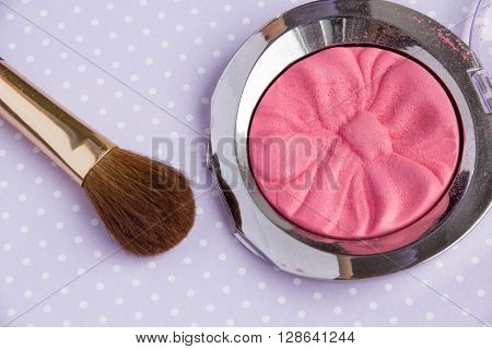 Powder Make Up Foundation Close Up With Detail and brush on a purple background, soft color bedding, decorative cosmetics on light background colorful, Pink Blush