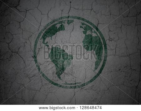 Studying concept: Green Globe on grunge textured concrete wall background