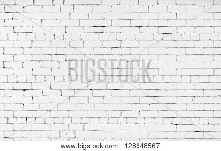 Brick wall painted in white color. Texture of the brickwork. White brick wall background.