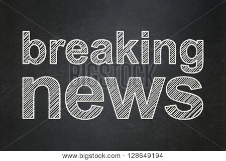 News concept: text Breaking News on Black chalkboard background
