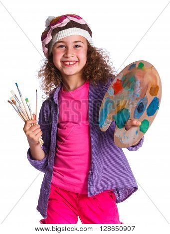 Artist girl at work. Isolated on the white background.