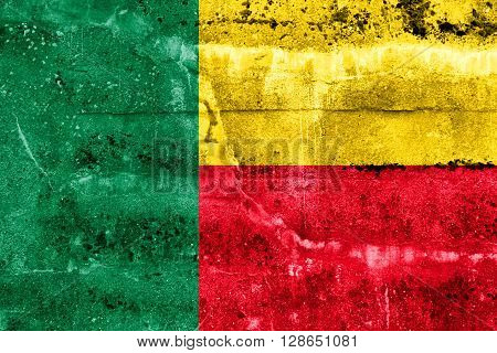 Benin Flag painted on grunge wall. Vintage and old look.