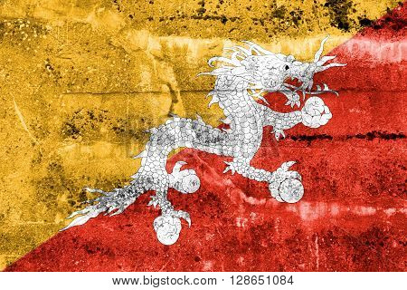 Bhutan Flag painted on grunge wall. Vintage and old look.