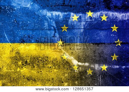 EU and Ukraine Flag painted on grunge wall. Vintage and old look.