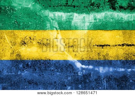 Gabon Flag painted on grunge wall. Waving and old look.