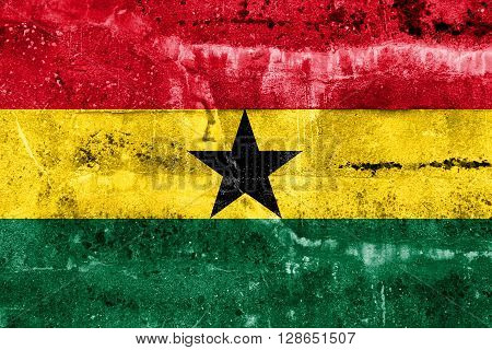Ghana Flag painted on grunge wall. Vintage and old look