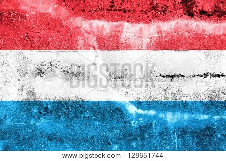 Luxembourg Flag painted on grunge wall. Vintage and old look.